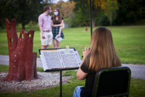 richmond symphony orchestra outdoor player couple
