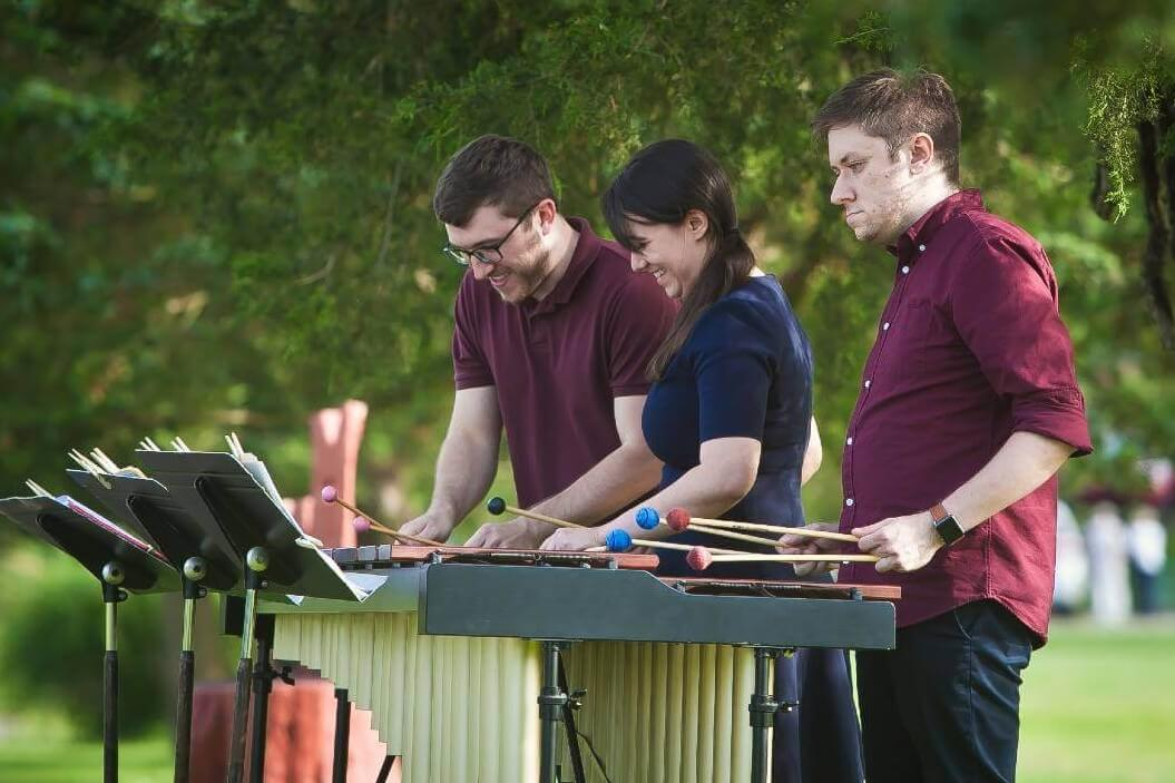 rso percussionists playing outdoors